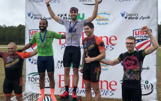 Athlete Anthony Y. grabs the top step